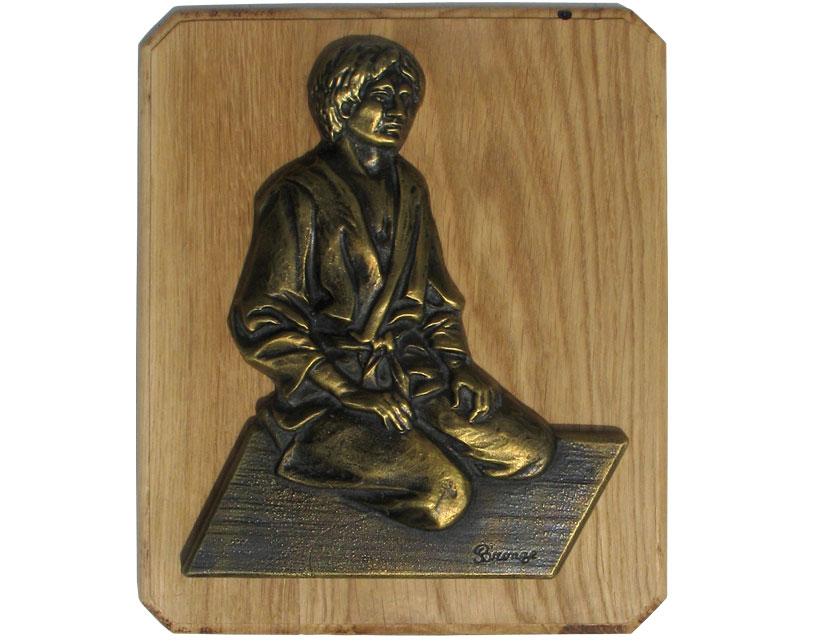 Plaque décorative en bronze sur support bois